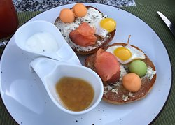 Salmon and quail eggs on bagels at Essence