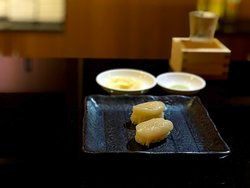 Hokkaido Scallop Nigiri sauced with Chef Murata's yuzu ponzu