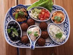 Our most popular dish:   the mezze platter, it is a medditeranean mixt of different things:  tzaziki, mouhamarra, humus, eggplant dip, marinated black olives and falafels.