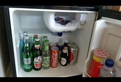 Mini Bar filled with lots of drinks.