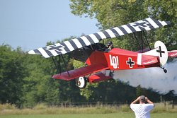 I think that LO! is an accurate expression of getting to watch a WWI fighter take off right in front of you.