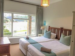 Greenhole Cottage - one of the bedrooms with a stunning view of the lagoon