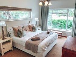 Greenhole Cottage main bedroom, en-suite, stunning lagoon view