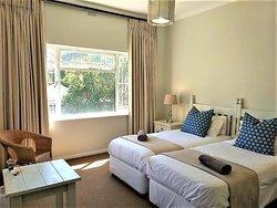 Greenhole Cottage bedroom, sunny with a garden view