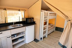 Kitchen nook in tent with 4 beds w/ bathroom
