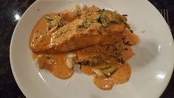 Salmon with pink sauce and risotto