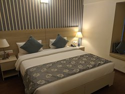 Bedroom with a double bed and bedside lights.