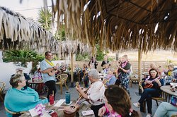 Cocktails & ukulele playing on the Pukiki terrace - Photo by Megan Spellman - Bikini Birdie Photography