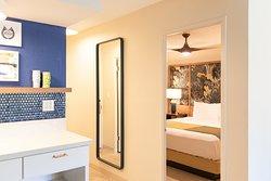White Sands Hotel 1 Bedroom Suite - Bedroom & Kitchenette