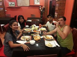 A beautiful family enjoying authentic Indian food at Highway Curry