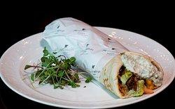 Lunch Menu Main Course - Souvlaki Roll - Chicken Thigh Skewer, lettuce, tomato, tzatziki, french fries.
