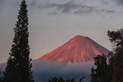 Incredible sunset view of Volcán de Fuego from the mirador terrace!