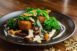 Root vegetable croquette, Goat's cheese sauce, toasted almonds, pickled wild mushrooms, parsley sauce