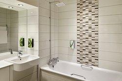 Premier Inn bathroom with bath and shower