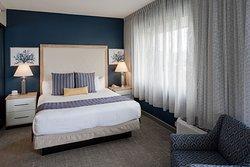 One Bedroom Suite - L Shape Room Bedroom Area.
