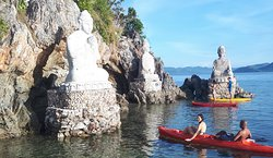 Visitors at the Bay of Buddhas on kayaks