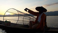 Inle fisherman is showing his alive fish to us in Inle lake ,Myanmar.