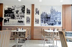 A side of the eating area which also captures the historic pictures of Leicester.