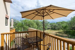 Spanish Colonial Junior Suite Views from the private deck, enjoy this pastoral setting with mountain views.
