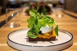 Toast with pumpkin, goat cheese and salad dressing.