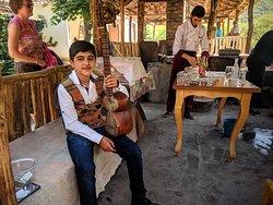 Day trip to Armenia - Armenian boy playing traditional music