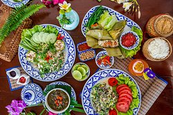 Lao degustation menu - Discover Lao flavors from different regions of the country. Your dinner is composed of 5 different dishes, all served at the same time, and ends with a mango sticky rice dessert. All products are coming from the Vang Vieng morning market.