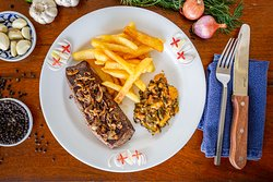 Grilled Flank Steak (Imported) with Shallot and Butter Sauce and French Fries