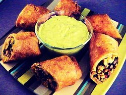 Chicken Egg Rolls Appetizer served with guacamole