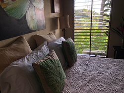 Wood slatted curtains overlooking the jungle.