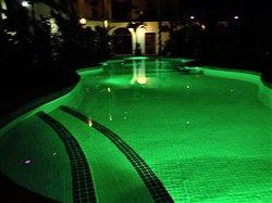 Hotel Lagoon Pool Lights at Night - Green