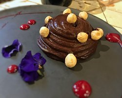 Cocoa and avocado mousse with hazelnuts and raspberry coulis