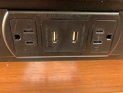 USB outlets by the desk.  There is another similar one near the coffee maker