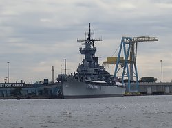 The USS Camden can be seen across the Delaware river.