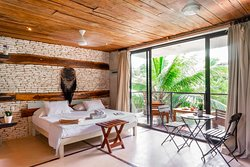 BEST VALUE FOR MONEY: Huge design rooms with tropical views, comfy beds, kitchenette, air conditioning and small prices in the best location along the famous Tulum Jungle road, just 2 minutes walking distance to the beach