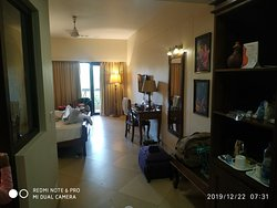 Uday suits hotel room and outside view photographs