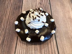 Mexican Hot Chocolate: Chocolate donut chili infused chocolate glaze topped with marshmallows vanilla whip!
