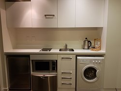The room had a washing machine as well as a microwave and a dishwasher