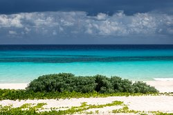 Set between the tropical jungle foliage and the picturesque turquoise waters of the Caribbean Sea