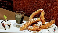 Rum-kissed Churros with hot chocolate sauce