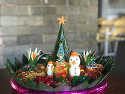 Nasi Tumpeng (Christmas Edition)  Nasi Tumpeng is an Indonesian dish which is normally served with yellow rice, chicken, egg, veggies among many more. Nasi Tumpeng is served on events / parties such as cakes in the western comunity.