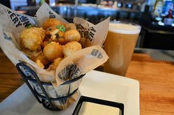 Watonga Cheddar Curds Beer-battered Watonga cheddar curds. Served with ranch dressing