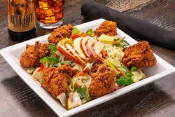 The Best Fried Chicken Salad  Fried chicken, fresh greens, broccoli, sweet peppered bacon, red pepper, carrots, sunflower kernels, raisins, shredded Parmesan and red delicious apple. Tossed in parmesan garlic dressing