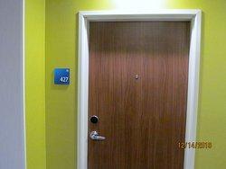 Outside the door of Room #427.