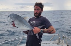 Thursday 26th December 2019 Luke and his GT (Giant Trevally) while popper fishing on the reef from Cairns