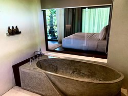 bath tub is made of concrete, interesting cool touch!