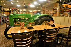 John Deere tractor next to dining tables