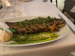 Cozy and her son to a wonderful job. Great atmosphere. The trout in the pic is deboned at your table. The scallops were perfect and the flaming Greek cheese starter was as great as it was dramatic. Reserve and go