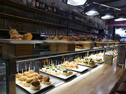 The display of its delicious tapas on the long bar table 4
