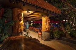 Full Lono on the left and hangry KŪ to the right greet those who find the secret entrance on Prince Edward Street