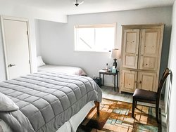 The Annex is our newest building that has 4 suites. Each room is equipped with a private bath, queen, and twin bed. This image is of Annex 3.